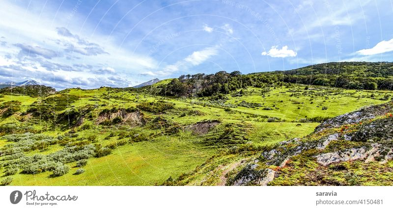general  view  of  the  field  on  a  clear  day nature natural clouds landscape colors green mountain vacation outdoor travel