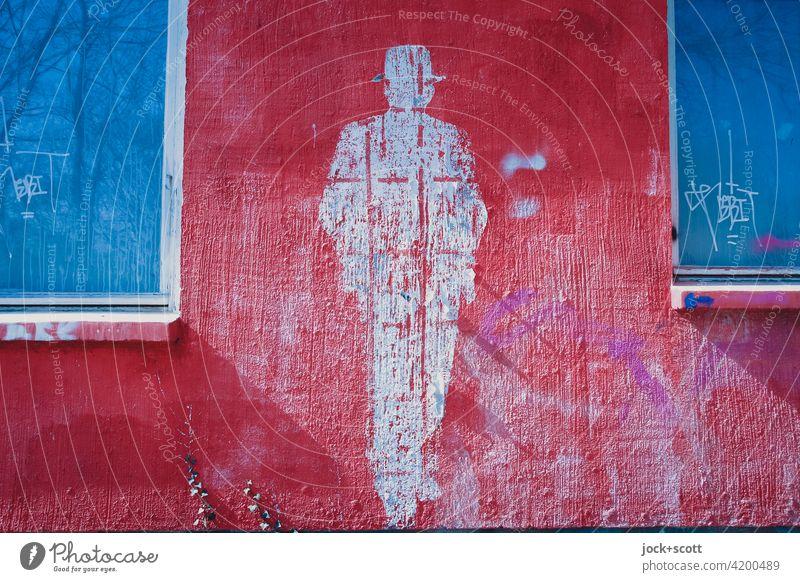 Gestalt einer Person abgelöst von einer Putzfassade in Farbe Körperhaltung Straßenkunst Subkultur Stil Lifestyle Silhouette Kreativität Abdruck Hut Wand