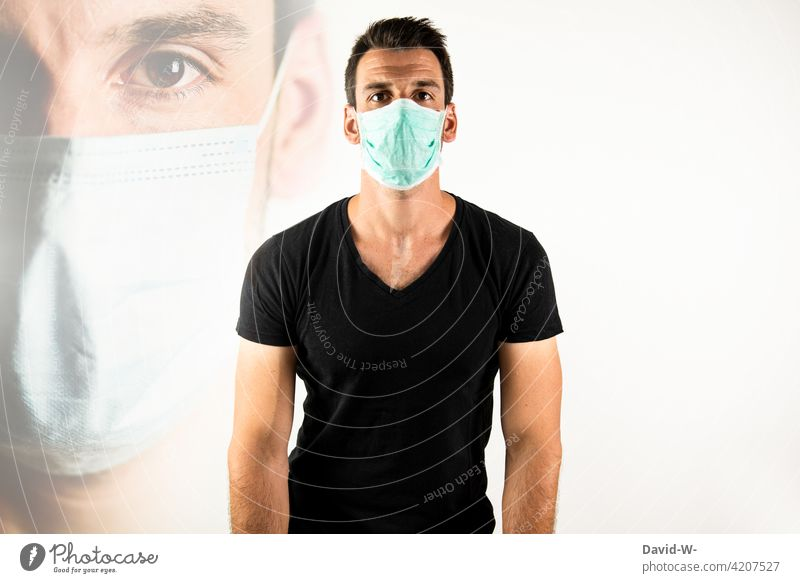 Mann mit Mundschutz / Atemschutzmaske Maske Corona Pandemie coronavirus schützen Maskenpflicht