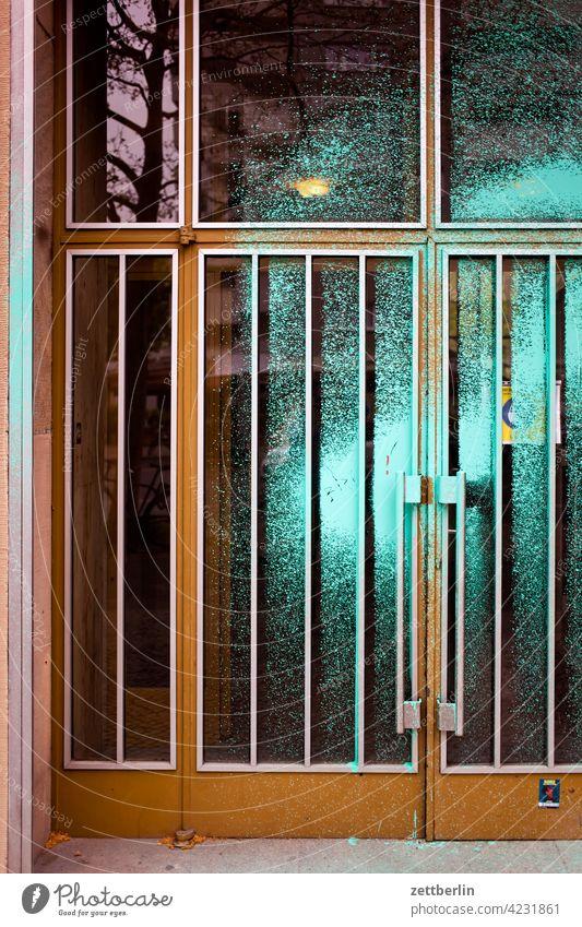 Besprühte Tür again aussage botschaft eingang farbe gesprayt grafitti grafitto illustration kunst mauer message nachricht parole politik sachbeschädigung