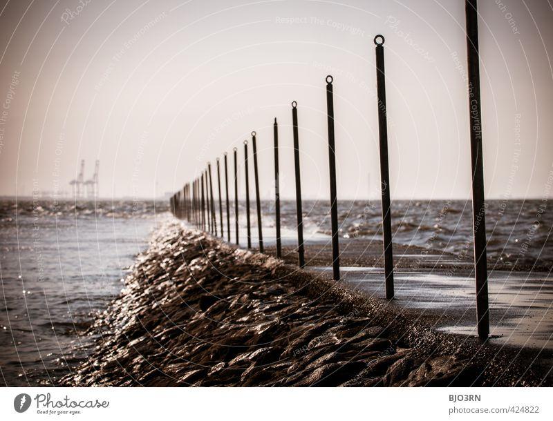 Kräne | Duo #2 Schifffahrt Container Ferne Jade Weser Port Tossens Kran Küste Steg Stein Stab Begrenzung Gischt Anlegestelle Meer Nordsee dunkel Horizont Teer