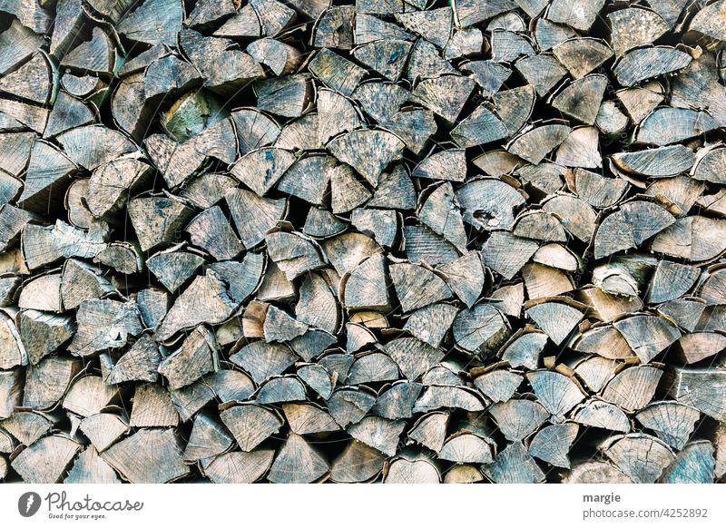 Gestapeltes Holz Baum Baumrinde Nahaufnahme Baumstamm Brennholz Natur Menschenleer Forstwirtschaft Totholz Brennstoff Abholzung Stapel Nutzholz geschnitten