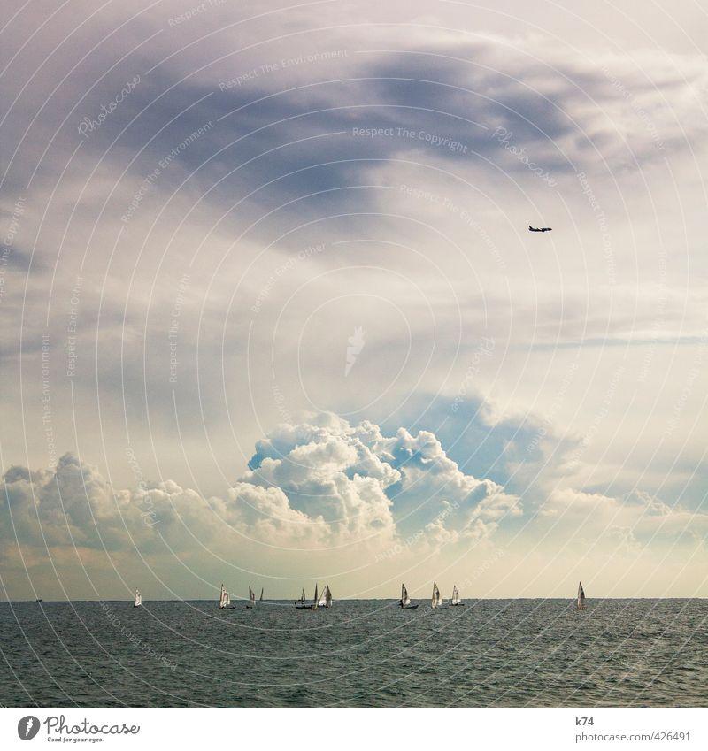 seascape Sommer Meer Wellen Wasser Himmel Wolken Gewitterwolken Wetter Verkehrsmittel Schifffahrt Bootsfahrt Segelboot Luftverkehr Flugzeug fahren fliegen blau