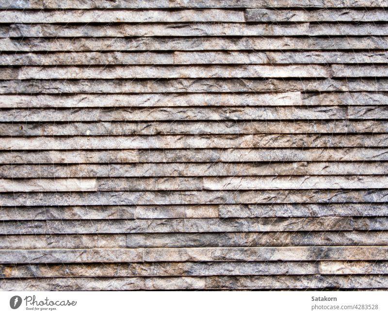 Sandsteinziegel an der Wand Architektur Klotz Baustein braun Stein bauen Konstruktion Dekor Detailaufnahme Korn Material natürlich Muster Teile Reihe Form