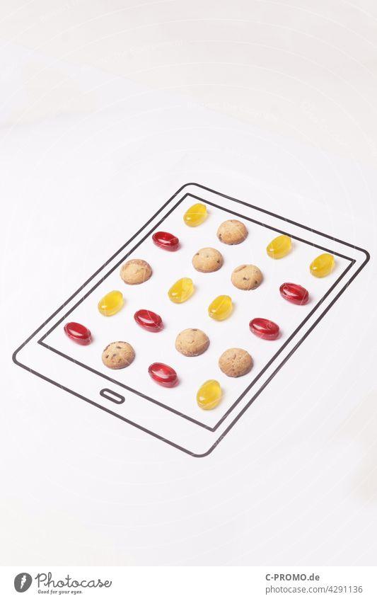 Analoges Candy Crush candy crush app mobil-game spiel puzzle-computerspiel essen obst süss weiß isoliert lecker close up köstlich übergewicht spielsucht zucker