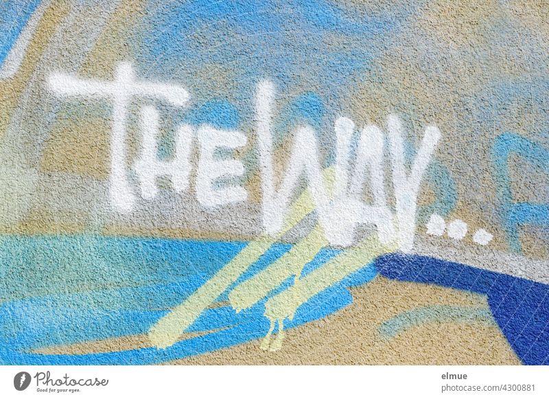 THE WAY ...   ist in weiß an eine Graffitiwand gesprüht / Graffito / Jugendkultur / Orientierung the way der Weg englisch blau Wand sprayen sprühen