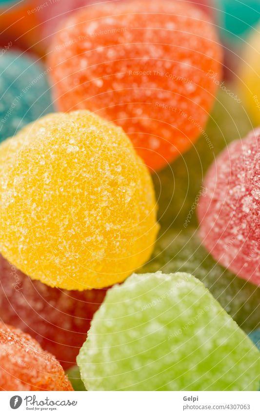 Bunte Gummibärchen als Tapete verwenden süß Zucker Bonbon orange Götterspeise Lebensmittel abschließen grün Konfekt Hintergrund farbenfroh gelb festlich