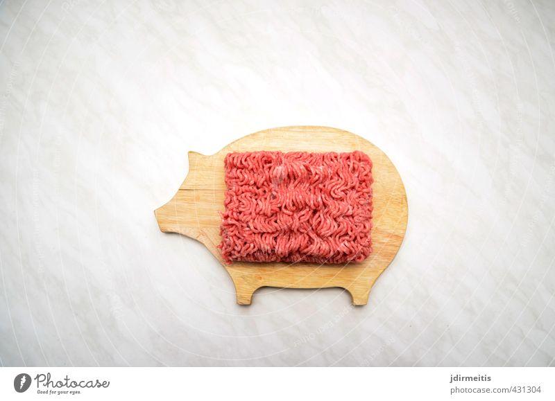 Hack Lebensmittel Fleisch Ernährung Mittagessen Nutztier Holz Surrealismus Schneidebrett Farbfoto Innenaufnahme Experiment Menschenleer Tag Blitzlichtaufnahme