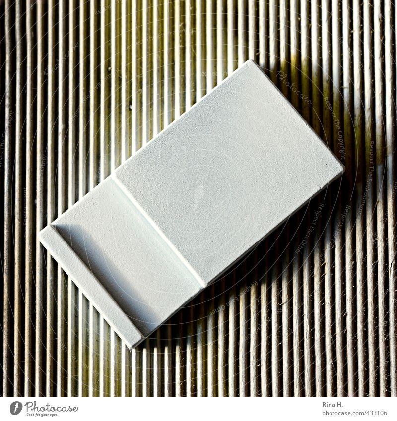Rechteck im Quadrat Riegel eckig Karton gestreift quer Muster graphisch Sicherheit Farbfoto Menschenleer Textfreiraum Mitte Licht Schatten