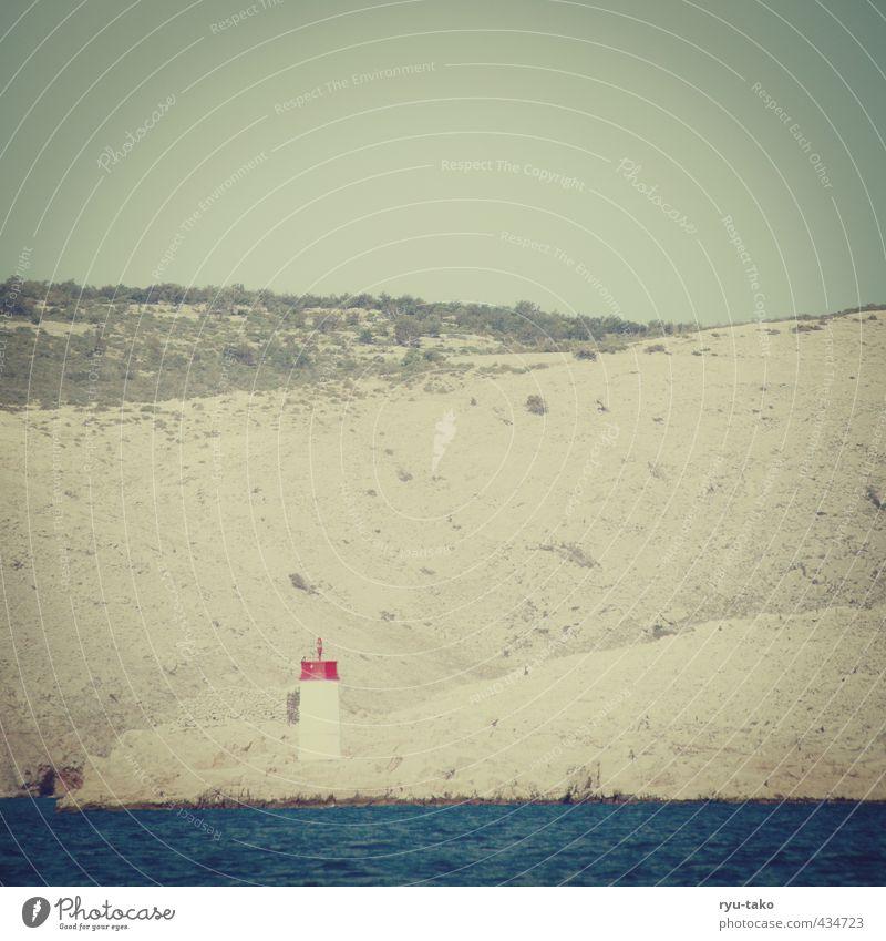 a Leuchttürmle Landschaft Erde Sand Himmel Sträucher Hügel Meer Ferne frei retro Leuchtturm trocken einzeln Farbfoto Außenaufnahme Menschenleer