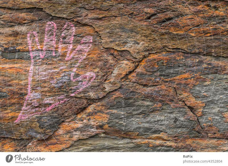 Gezeichnete Hand auf einem oxidierten Naturstein. Mauerwerk Stein urban Fugen Graffiti Bauwerk Steinwand Wand streetart Subkultur Kultur Lebensraum Architektur