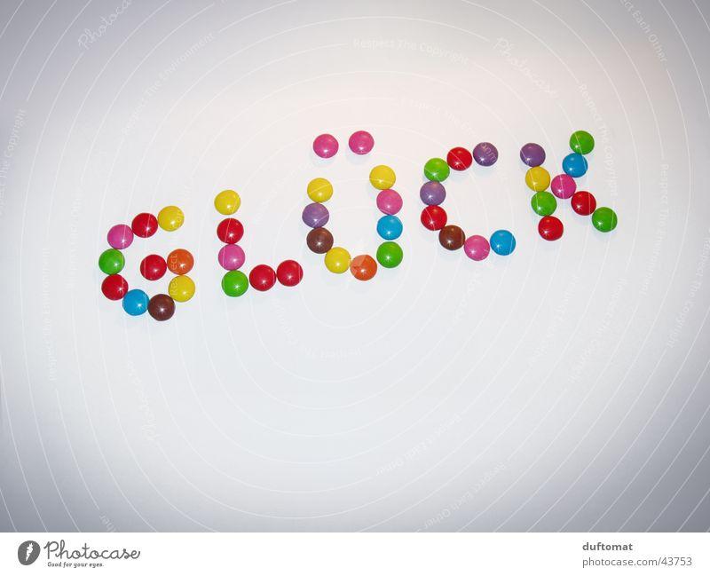 Schoko-Glück Süßwaren Schokolade Freude Schriftzeichen lecker süß Schokolinsen glücklicherweise Wort Buchstaben Großbuchstabe knallig Schlagwort Glückwünsche