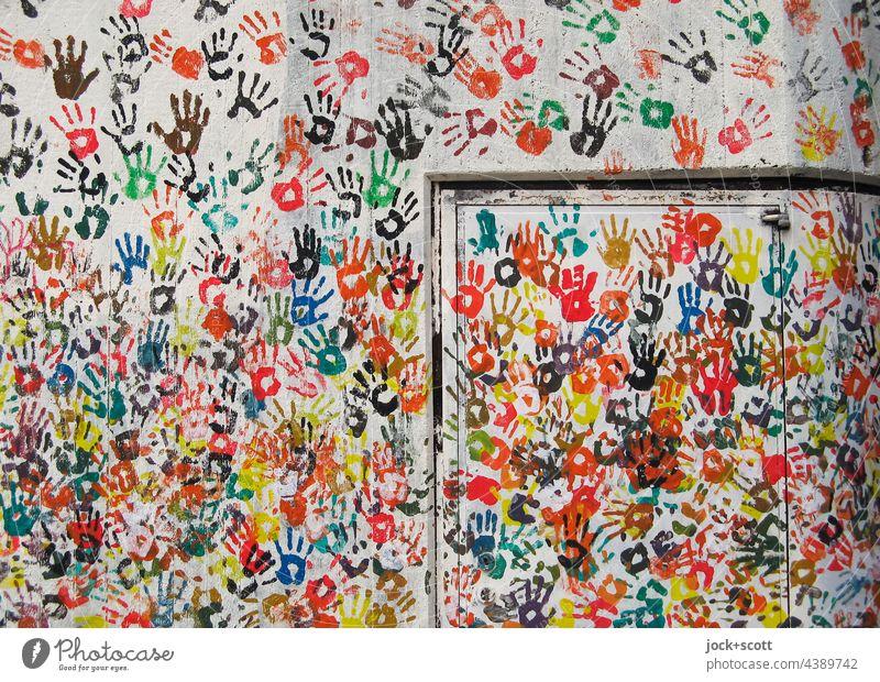 Hand für Hand auf Wand Straßenkunst Abdruck viele Teamwork Farbenspiel Kreativität Einigkeit abstrakt Silhouette Dekoration & Verzierung Hintergrundbild