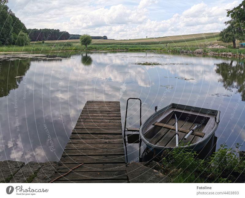 """""""Ein kleines Stückchen Paradies"""" dachte sich Fotoline, als sie an dem kleinen Teich auf das Ruderboot schaute. """"Bleib ich auf dem Steg oder fahr ich ne Runde?"""""""