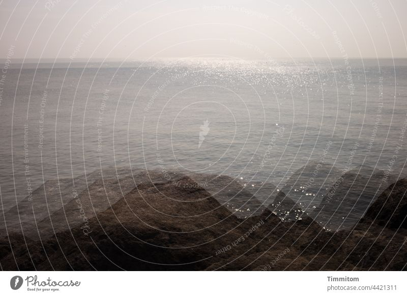 Steine einer Mole, glänzende Nordsee und sanfter Himmel - Mehrfachbelichtung Befestigung Damm Wasser ruhig Horizon Ferien & Urlaub & Reisen Menschenleer