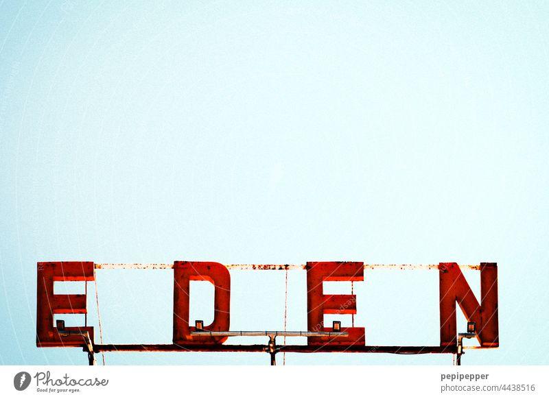 EDEN jenseits von Eden schild Neonlicht neonfarbig Buchstaben Typographie Tippfehler typografisch schrift Leuchtreklame Schilder & Markierungen Farbfoto Fassade
