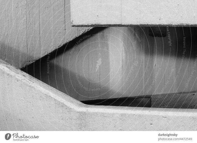 Beton Architektur im Detail mit unterschiedlichen Ebenen, Diagonalen, Vertikalen und Horizontalen Bauelement Außenaufnahme Licht Fertigteil Kreativität
