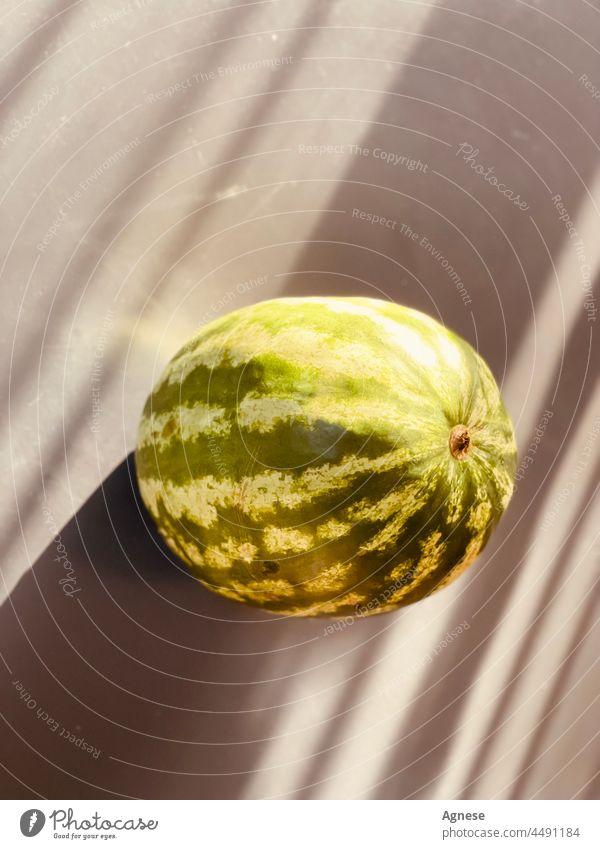 Wassermelone mit Sonnenuntergangstönen Wassermelonen Frucht fruchtig Schattenspiel