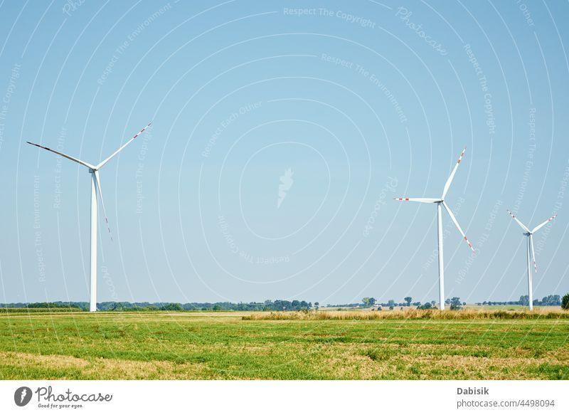 Windturbinengenerator im Einsatz regenerativ Energie Ökostrom Windmühle Windkraftanlage Erzeuger Turbine Ökologie Ackerbau alternativ Hintergrund Klinge