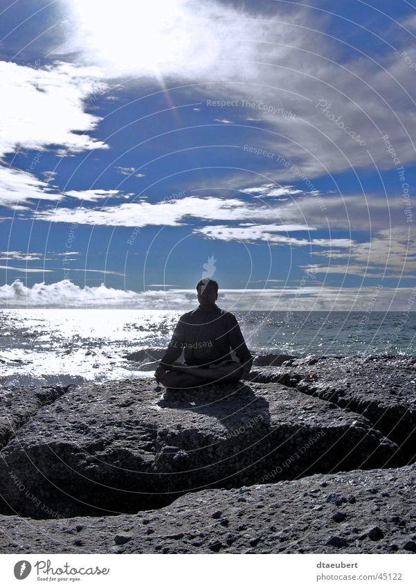 Meditation on the rock Mensch Mann Wasser weiß Sonne Meer grün blau Sommer schwarz Wolken Erholung Glück Stein Religion & Glaube Küste