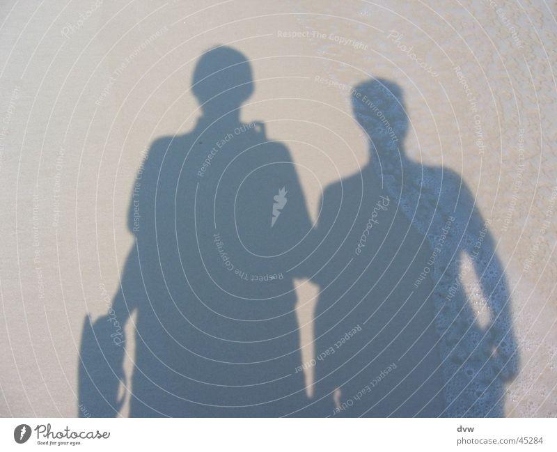 Schattenmänner Schattenspiel Pensacola Strand Selbstportrait Physik Meer Wellen Mann weisser Sand Sonne Wärme