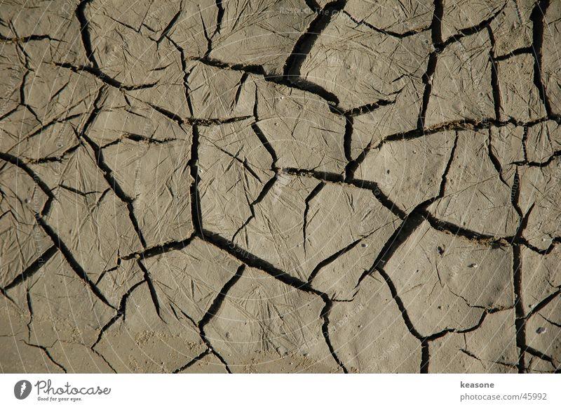 broken braun labil Schlamm Pfütze Technik & Technologie Tanzfläche Erde gebrochen earth mud Wasser Bodenbelag