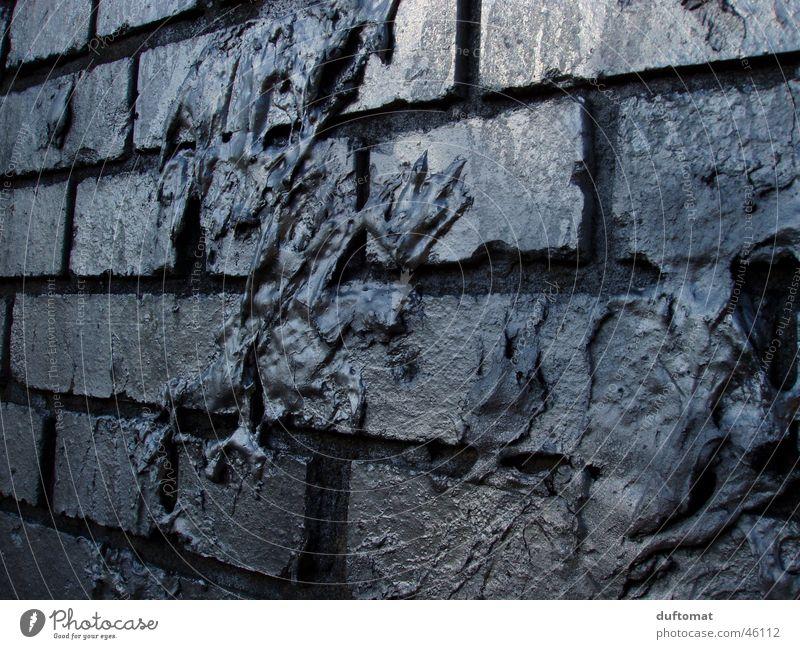 Der Blob Wand grau Mauer dreckig Backstein silber Chemie Schleim Auswurf