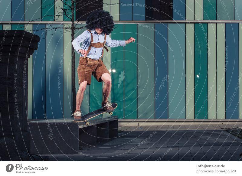 In Lederhose blau Stadt Junger Mann Mauer Architektur springen fliegen Aktion gefährlich sportlich München Skateboarding Tradition Skateboard Bayern Sportler