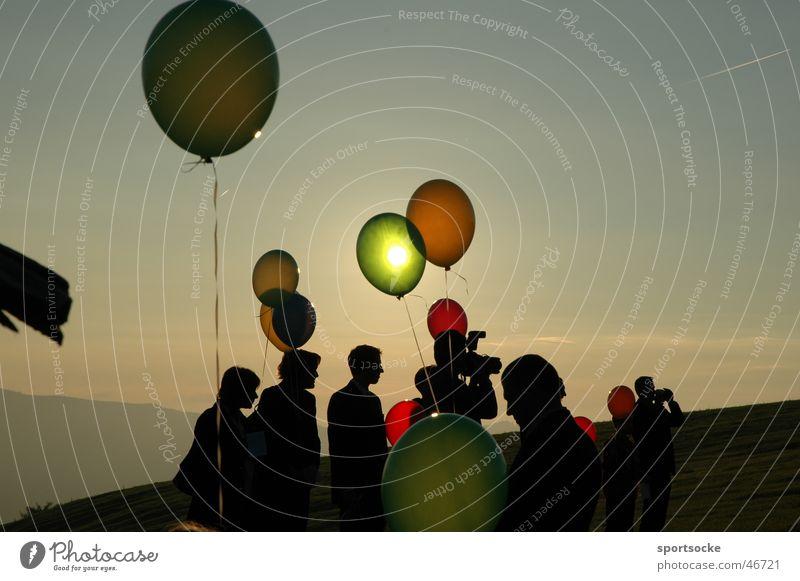 Sonne in Ballon Mensch Luftballon Lichtspiel
