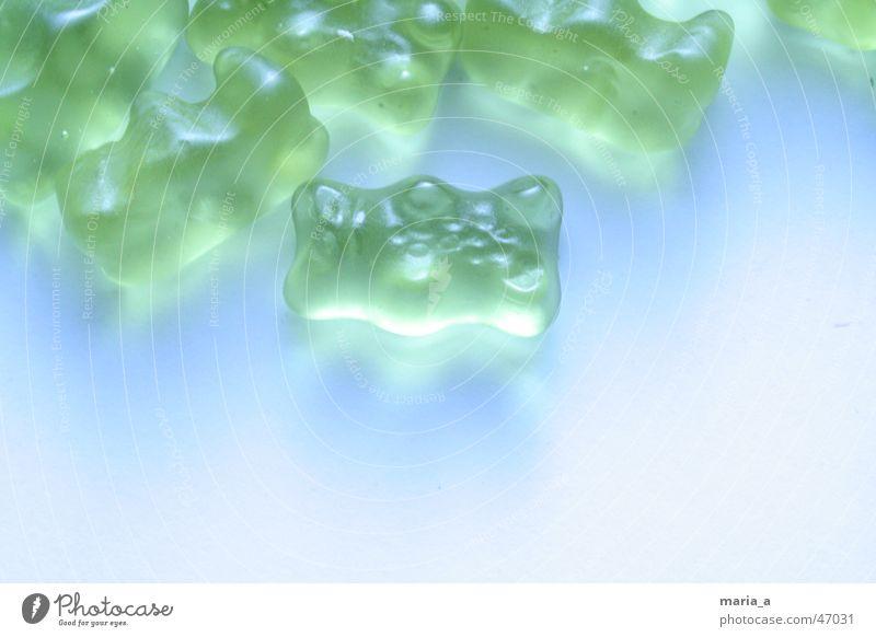 Gummibaerchen #1 blau grün Lampe mehrere viele Süßwaren ungesund Gummibärchen Vordergrund wichtig verstrahlt Weingummi