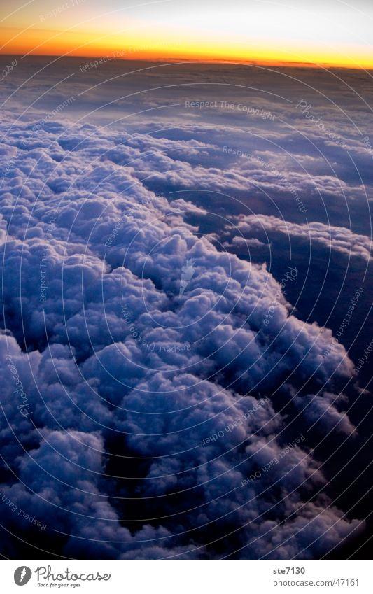 Sunset over the Clouds Himmel blau rot Wolken Ferne Schnee Freiheit fliegen Abdeckung