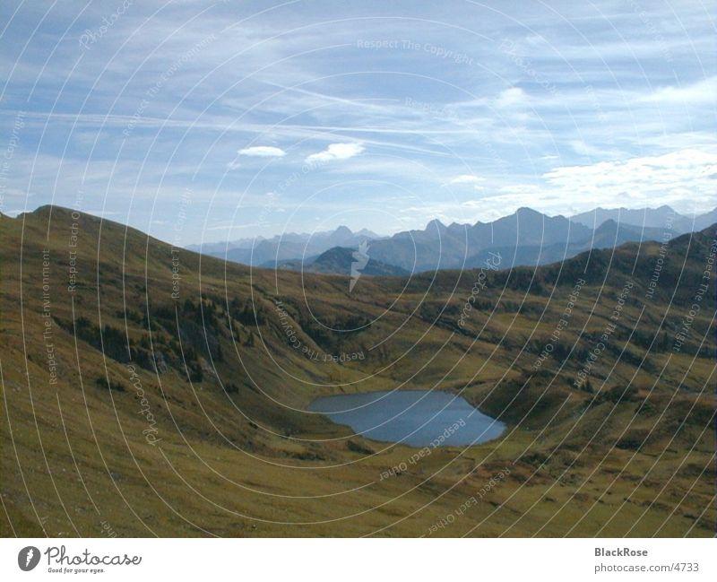 Bergsee Gebirgssee ruhig Alpen Himmel