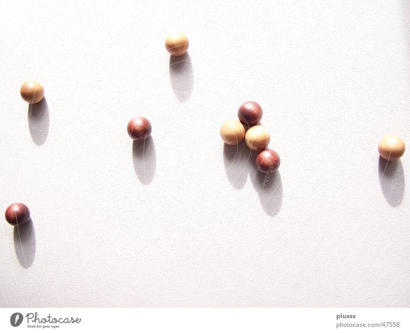 kugelrund Kreis dunkelbraun hellbraun Holz Zufall Kugel streuung Schatten