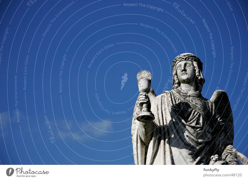 Raising a toast to heaven Licht Frieden Religion & Glaube Statue Himmel calm catholic cemetery light Denkmal ray religious stone graveyard cropped looking