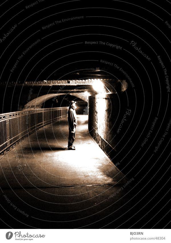 the shining #01 Licht Einsamkeit Erkenntnis Mann dunkel schwarz Mensch Idee Brücke unterführing Schwarzweißfoto Sepia hell alone