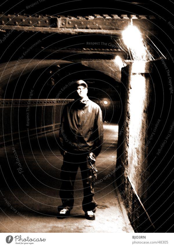 the shining #02 Licht Einsamkeit Erkenntnis Mann dunkel schwarz Mensch Idee Brücke unterführing Schwarzweißfoto Sepia hell alone