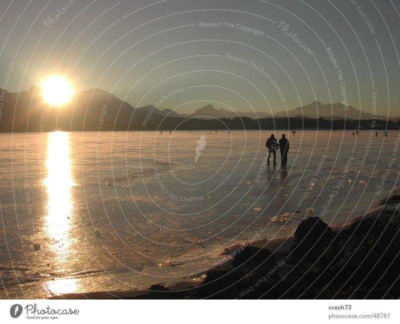 Hopfensee Mensch Sonne Winter kalt Berge u. Gebirge See Eis Allgäu