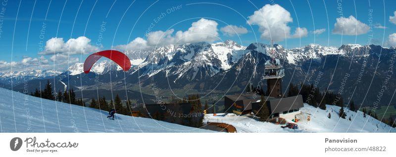 Paraglide start auf der Planai rot Wolken Berge u. Gebirge Schnee Sport Aktion Aussicht Schneebedeckte Gipfel abwärts Schneelandschaft Tal Berghang