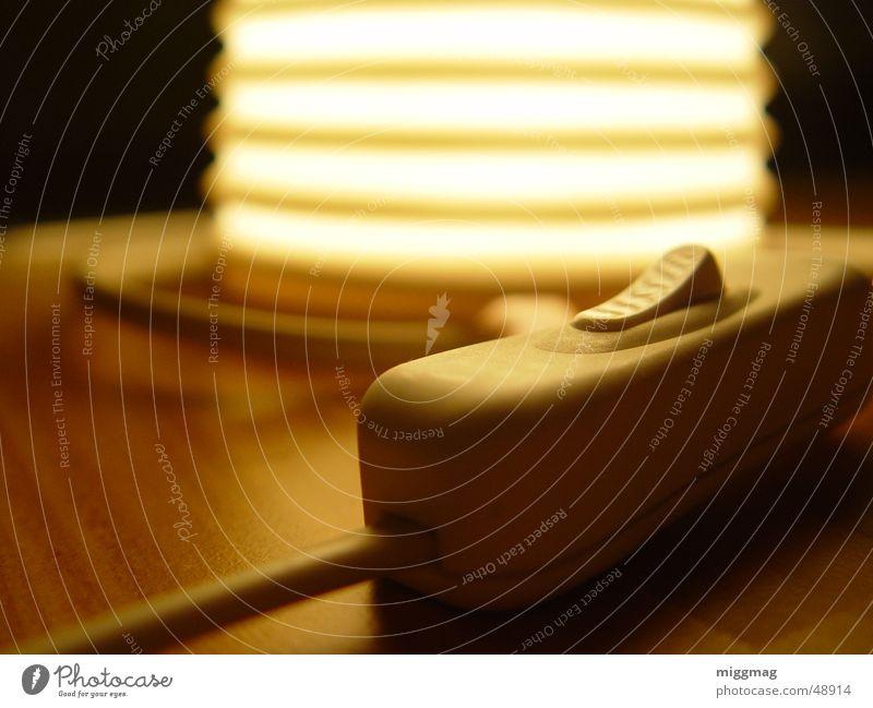 Lichtschalter schwarz ruhig Wärme Lampe Stimmung orange Energiewirtschaft Design Elektrizität Kabel Technik & Technologie Windkraftanlage Möbel Sonnenenergie Wohnzimmer Schalter