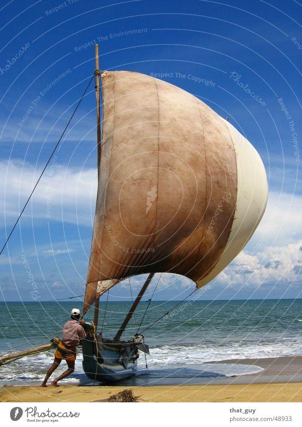 Reaching the Shore Sonne Meer Sommer Strand Ferien & Urlaub & Reisen Leben Freiheit Wasserfahrzeug Wind Perspektive Hoffnung Asien Mensch Segel Fischer