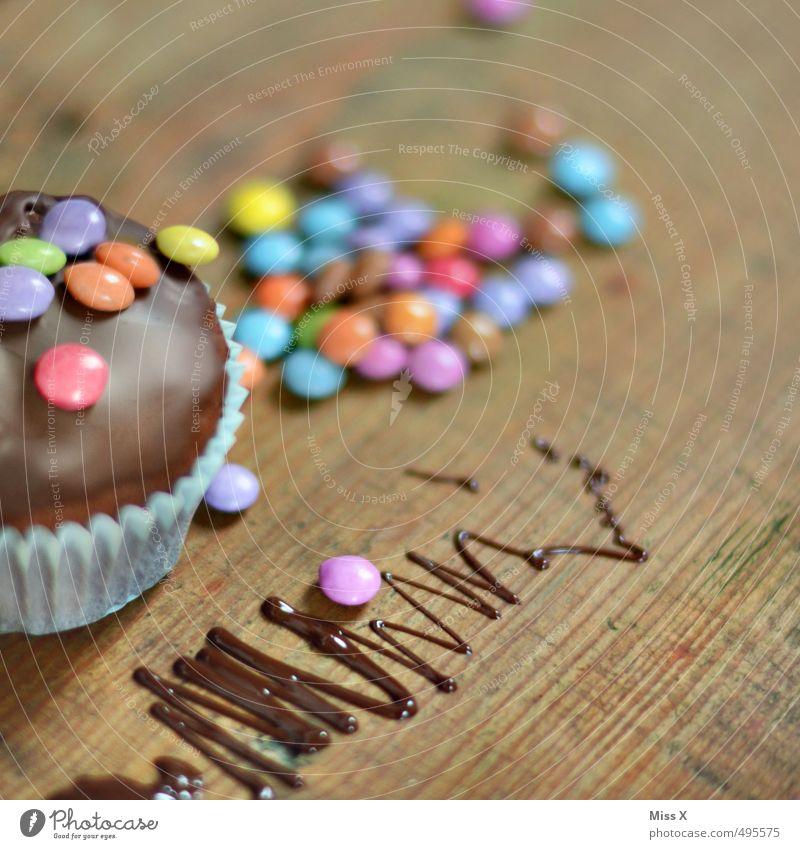 Linsen auf Muffin an Schokoladen Lebensmittel Teigwaren Backwaren Dessert Süßwaren Ernährung Kaffeetrinken lecker süß Schokolinsen Dekoration & Verzierung