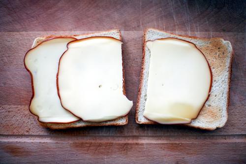 doppelt gemoppelt gelb liegen braun Zusammensein Lebensmittel authentisch paarweise Ernährung einfach Pause rund lecker Frühstück eckig Backwaren Scheibe