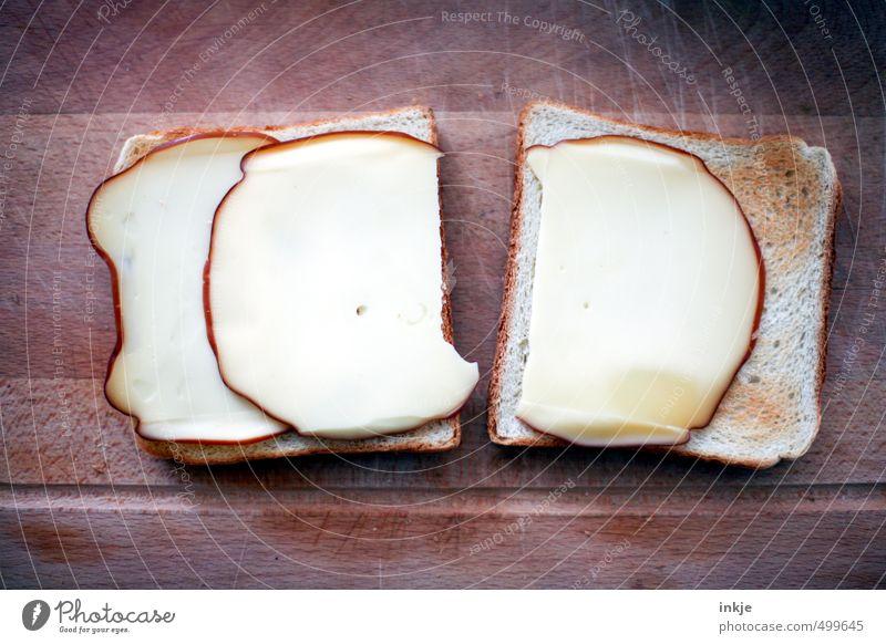 doppelt gemoppelt Lebensmittel Käse Teigwaren Backwaren Toastbrot Ernährung Frühstück Vegetarische Ernährung Fingerfood liegen authentisch eckig einfach