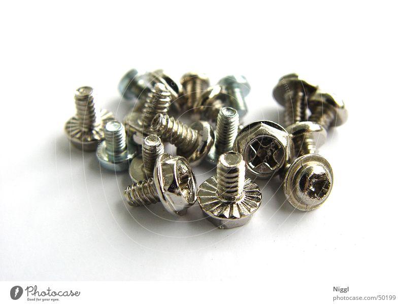 eine Herde Schrauben Handwerk Metall Drehgewinde Makroaufnahme niggl