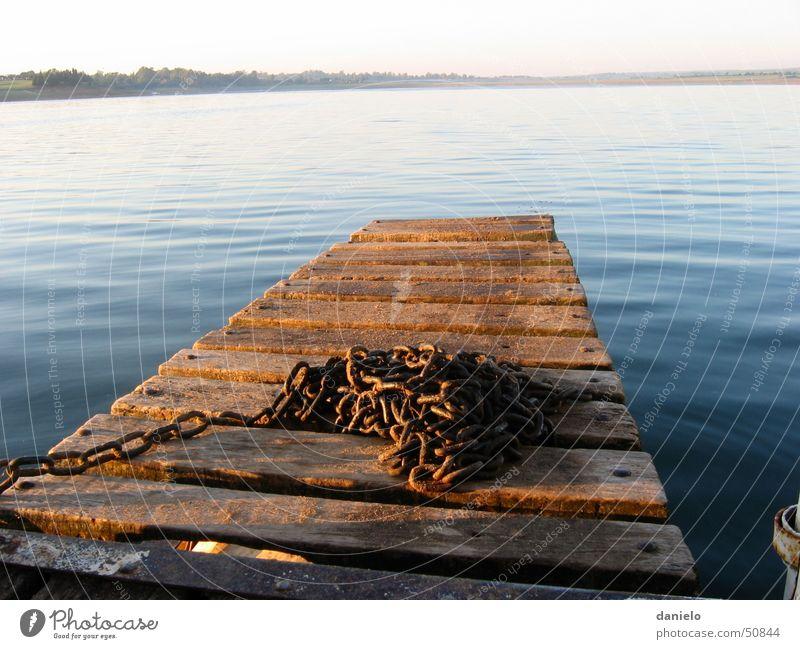 Morgenstimmung am See Wasser ruhig See Steg Kette