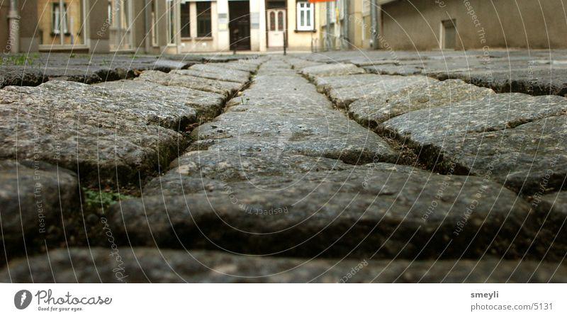ganz unten Stein Erde Bodenbelag Pflastersteine Granit