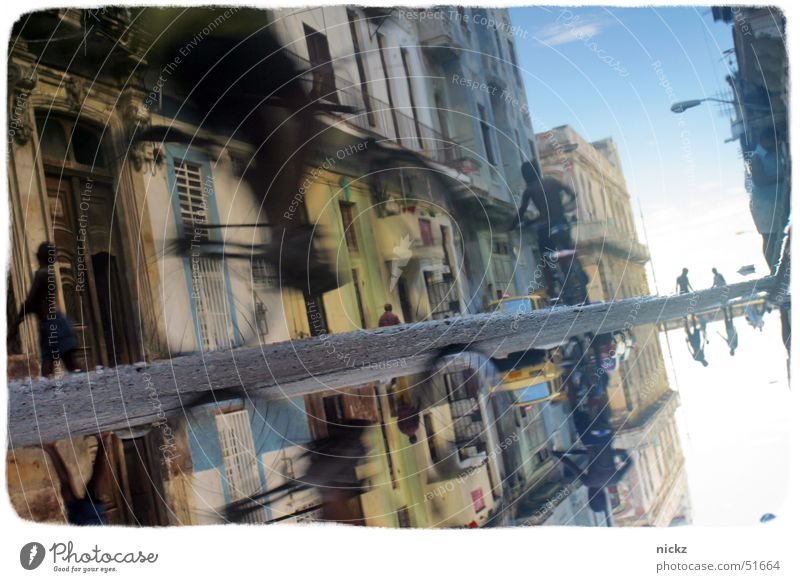 The City of Lost Children Himmel Straße Regen Fahrrad Kuba