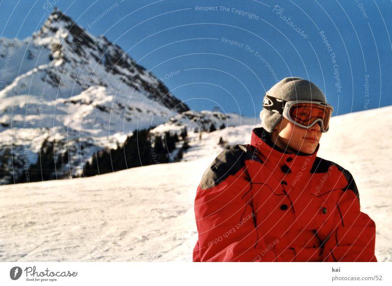 HangJunge01 Mensch Winter Berge u. Gebirge Schnee Sport orange Schönes Wetter Gipfel Skifahren Wolkenloser Himmel Jacke Berghang Skifahrer Wintersport Kind
