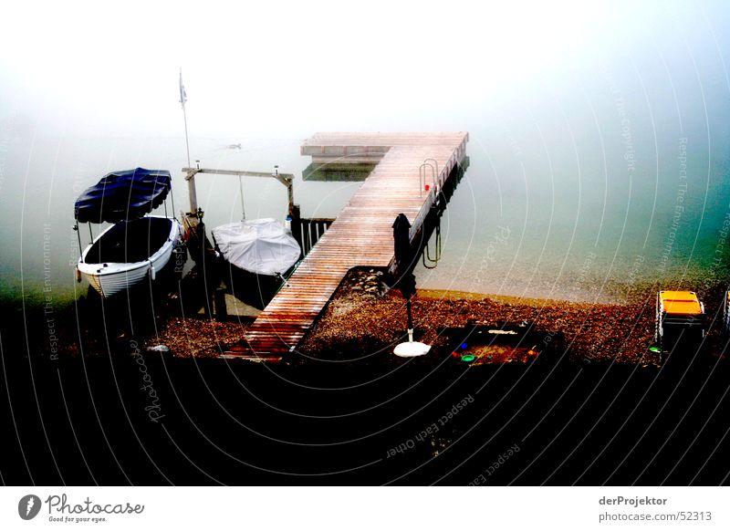 Wolfgangsee am Morgen Wasser ruhig Farbe See Wasserfahrzeug Nebel Steg September