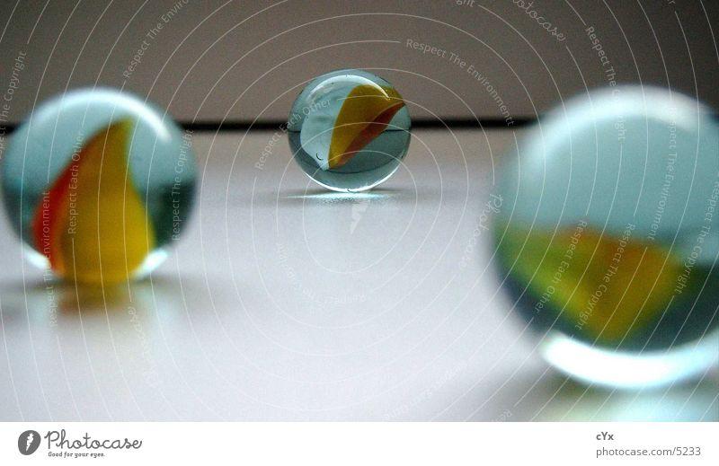 Glasmurmeln Murmel rund Ferne mehrfarbig Makroaufnahme Nahaufnahme glasmurmeln Perspektive Kugel Mitte